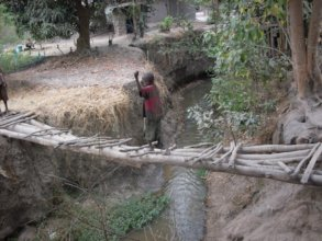 #1. Child crossing a wood bridge