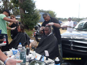 Our volunteer barbers provide free haircuts.