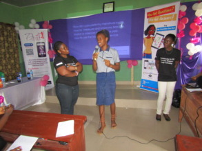 A girl asking a menstrual health question.
