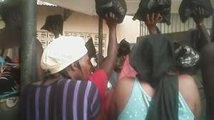 Women receiving AdvocAid welfare items in prison
