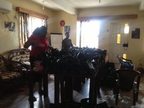AdvocAid's social worker, preparing welfare items