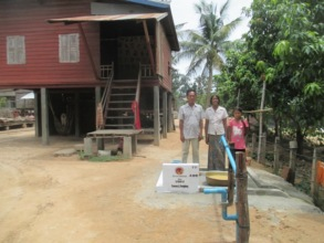 A rural Cambodian family with their new well.