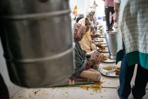 Special mid day meal served to widows for Holi