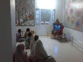 Widows during their evening prayer time