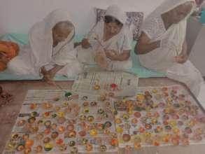 Mothers making Diyas