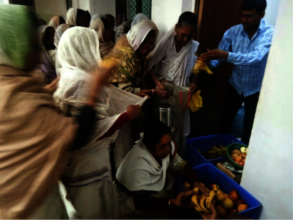 Fruits being distributed