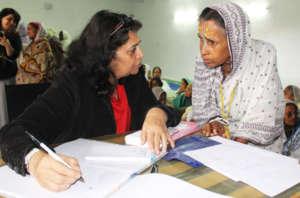A widow registers herself during healtch camp