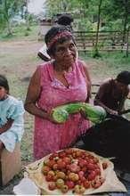 Bibidilia, a community elder, with her harvest
