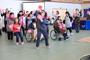 Participants dance to a popular song during lunch