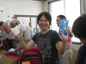 participant showing some evacuation kit contents