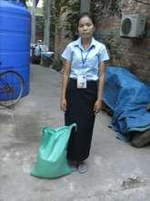 Chanthoeun receives a 15kg bag of rice weekly
