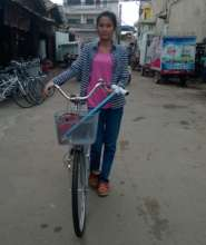 Kanha receives a bike through the program