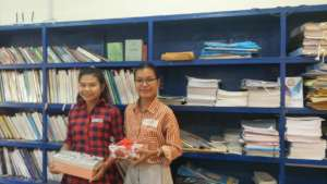 Sophin (left) receives gift for journal writing!