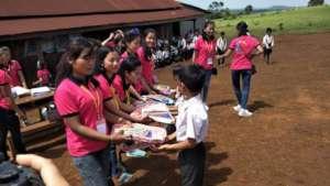 Students receiving study materials