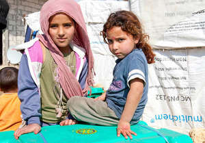 Refugee children with relief supplies