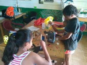Children working with recycled materials