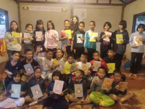 Happy kids with new stationary