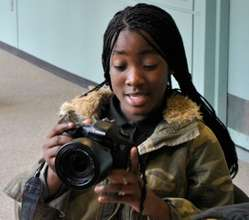 Amirah practices her camera skills at WHYY