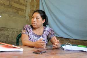 Maribel speaks with project staff