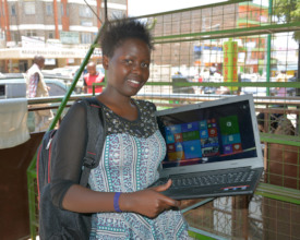 Silvia at college with her Global Giving lap top