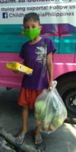 Eric, 9 years old, received his vegetable donation