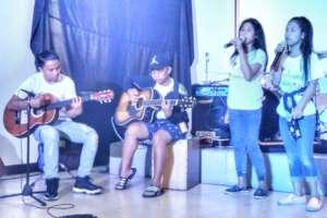 Street children sing popular songs