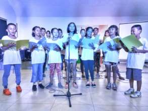 Street children sing Christmas carols