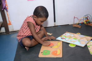 Creche Child exploring puzzle
