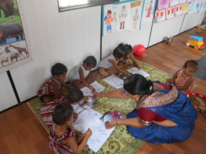 children at our centre doing collage work !