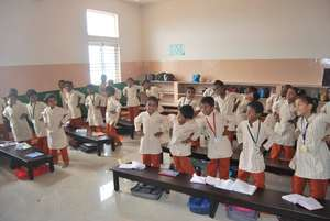 Students in a Isha Vidhya school class room