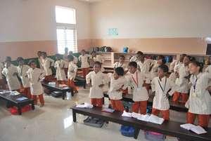 Students in a Isha Vidhya school class room