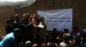 Children receiving learning kits in an IDP camp