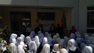 Girls receiving learning materials in Kabul