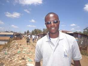 George Waweru in Kibera gathering video reports