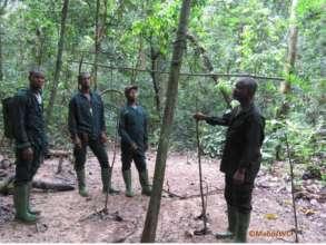 Anti-poaching team discovering a poacher camp