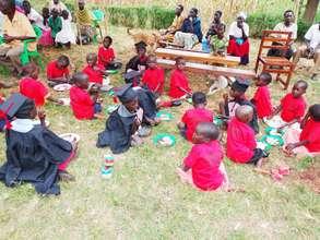 Children Enjoy a meal at the Center