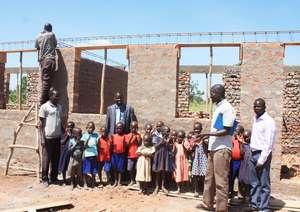 Children gather anxiously near New Class.