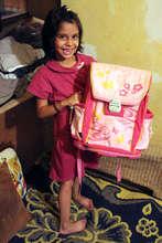 Anastasija Beaming with Pride about her school Bag