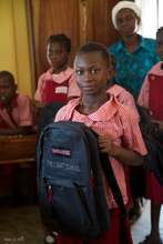 A Primary Student Proudly Shows Off Her Backpack