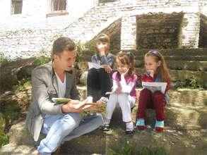 Librarian reads to children