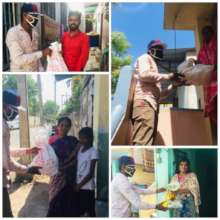 Volunteers giving groceries to centre management