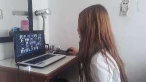 She is in class