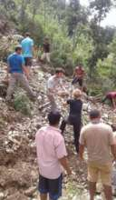 volunteers helping with washed out road
