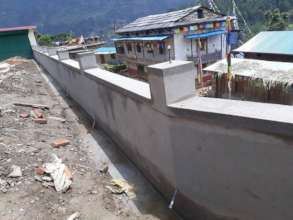 Rajbash Hospital's new retaining wall