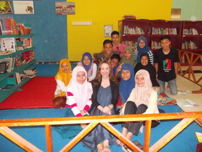 Ms. Webb with students in Aceh
