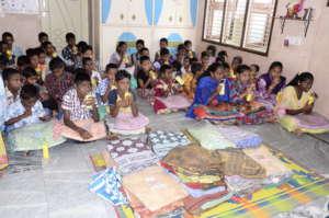 Orphan Children getting blankets Winter Donations