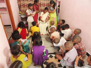 teacher giving classes to orphan children