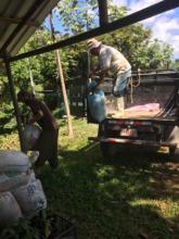 Luis unloading truck full of fertile compost