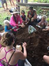 Filling tree bags with fertile soil!