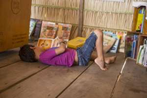 Boy enjoying a good reading at the library